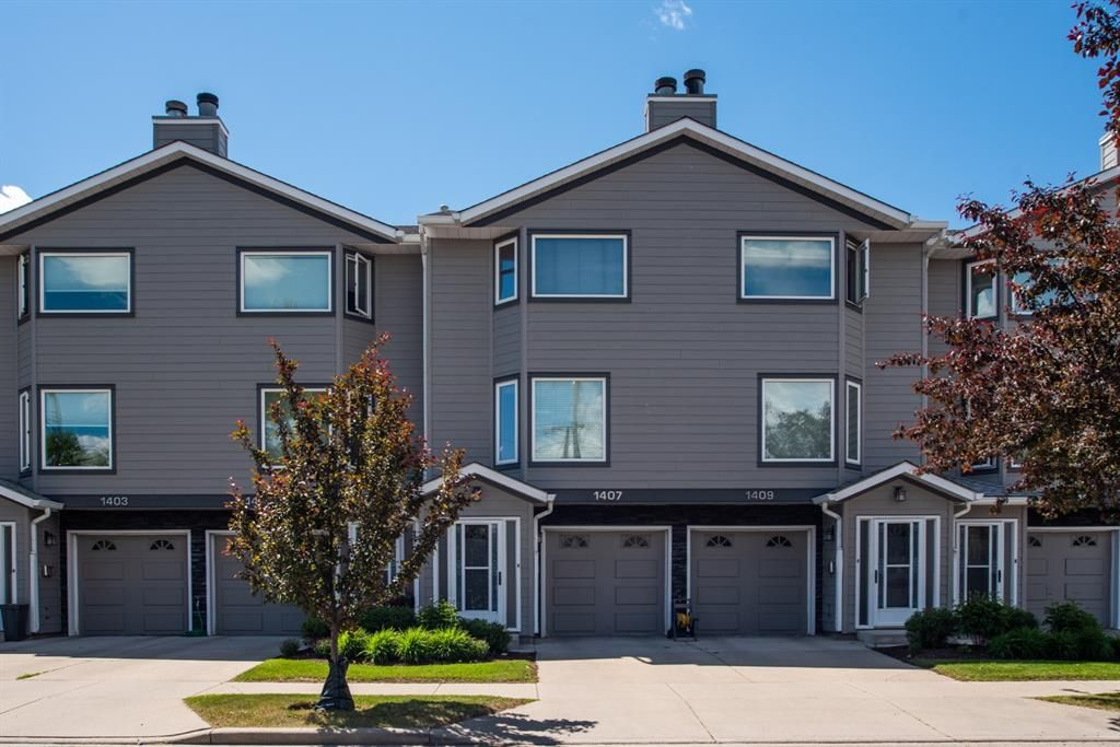Main Photo: 1407 1 Street NE in Calgary: Crescent Heights Row/Townhouse for sale : MLS®# A1121721