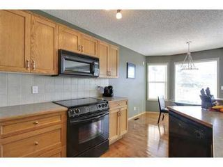 Photo 9: 290 COUGARSTONE Circle SW in Calgary: 2 Storey for sale : MLS®# C3586992