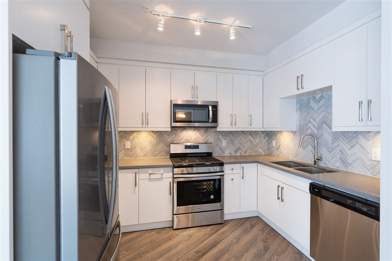 Main Photo: 408 14605 MCDOUGALL Drive in Surrey: Elgin Chantrell Condo for sale (South Surrey White Rock)  : MLS®# R2564482