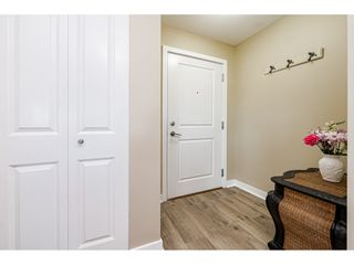 """Photo 3: B403 8929 202 Street in Langley: Walnut Grove Condo for sale in """"THE GROVE"""" : MLS®# R2612909"""