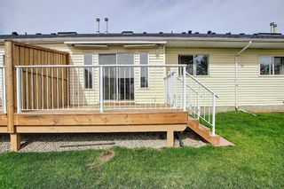 Photo 17: 8 12 Woodside Rise NW: Airdrie Row/Townhouse for sale : MLS®# A1108776