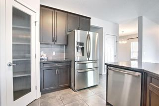 Photo 10: 61 Everhollow Green SW in Calgary: Evergreen Detached for sale : MLS®# A1115077