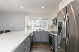 """Photo 4: 3359 FIELDSTONE Avenue in Vancouver: Champlain Heights Townhouse for sale in """"Marine woods"""" (Vancouver East)  : MLS®# R2570281"""