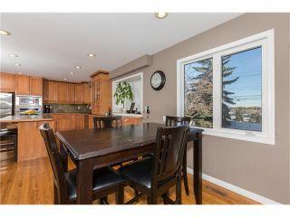 Photo 8: 1134 LAKE CHRISTINA Way SE in Calgary: Lake Bonavista House for sale : MLS®# C4051851