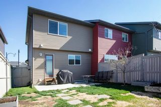 Photo 24: 64 Sunvalley Road: Cochrane Row/Townhouse for sale : MLS®# A1108247