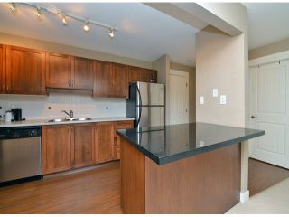 """Photo 6: 118 32725 GEORGE FERGUSON Way in Abbotsford: Abbotsford West Condo for sale in """"Uptown"""" : MLS®# F1417772"""