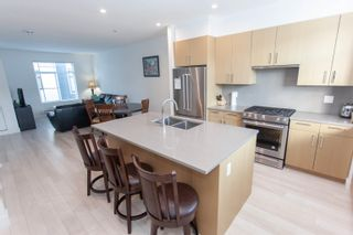 """Photo 3: 25 2427 164 Street in Surrey: Grandview Surrey Townhouse for sale in """"SMITH"""" (South Surrey White Rock)  : MLS®# R2624142"""