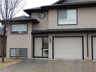 Photo 1: 31 103 FAIRWAYS Drive NW: Airdrie Townhouse for sale : MLS®# C3611153