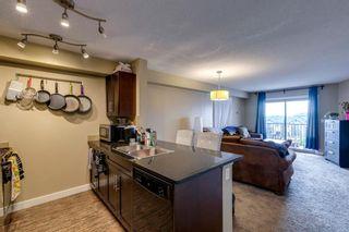 Photo 4: 404 355 Taralake Way NE in Calgary: Taradale Apartment for sale : MLS®# A1147050