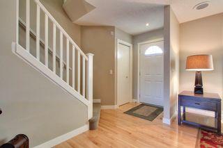 Photo 2: 39 West Springs Gate in Calgary: Duplex for sale : MLS®# C3601004