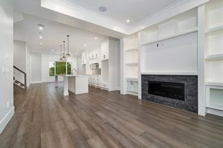Photo 7: 2331 (West) 27 Avenue NW in Calgary: Banff Trail Detached for sale : MLS®# A1033000