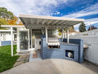 Photo 7: 48 Foxwell Road SE in Calgary: Fairview Detached for sale : MLS®# A1150698