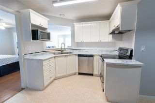 """Photo 9: 303 7435 121A Street in Surrey: West Newton Condo for sale in """"Strawberry Hill Estates"""" : MLS®# R2590639"""
