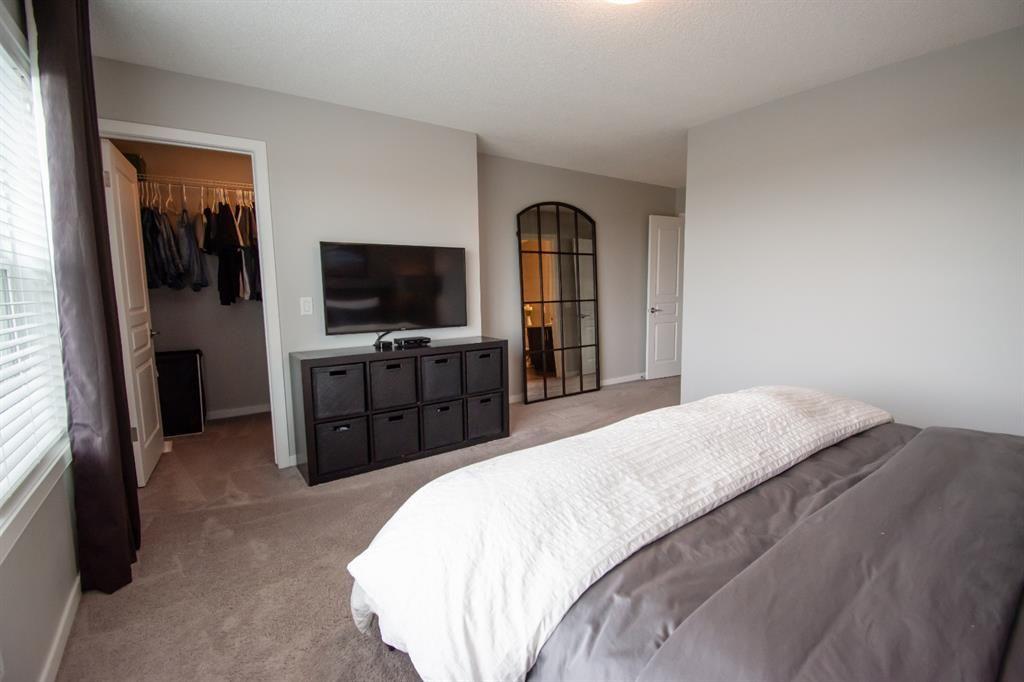 Photo 10: Photos: 281 AUBURN MEADOWS Place SE in Calgary: Auburn Bay Duplex for sale : MLS®# A1014528