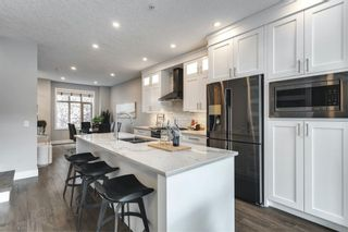 Photo 5: 8 11 Scarpe Drive SW in Calgary: Garrison Woods Row/Townhouse for sale : MLS®# A1138236