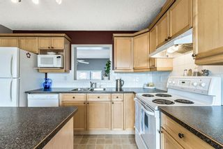 Photo 12: 6 Crystal Shores Cove: Okotoks Row/Townhouse for sale : MLS®# A1080376