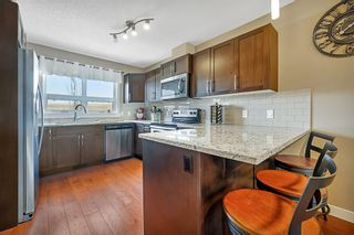 Photo 5: 404 2461 Baysprings Link SW: Airdrie Row/Townhouse for sale : MLS®# A1085181