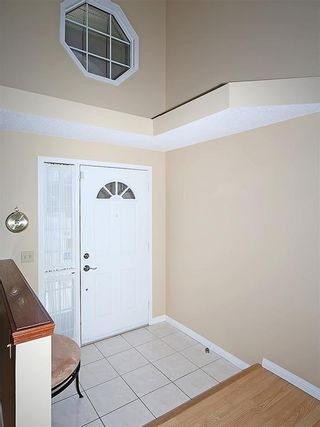 Photo 2: 114 SIGNATURE Close SW in Calgary: Signal Hill House for sale