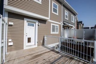 Photo 32: 122 Sunset Road: Cochrane Row/Townhouse for sale : MLS®# A1127717