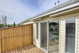 Photo 19: 8 12 Woodside Rise NW: Airdrie Row/Townhouse for sale : MLS®# A1108776