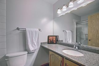 Photo 15: 104 Millview Green SW in Calgary: Millrise Row/Townhouse for sale : MLS®# A1120557