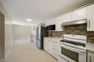 Photo 8: 4307 4A Avenue SE in Calgary: Forest Heights Row/Townhouse for sale : MLS®# A1142368