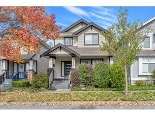 """Photo 1: 18883 71 Avenue in Surrey: Clayton House for sale in """"Clayton"""" (Cloverdale)  : MLS®# R2621730"""