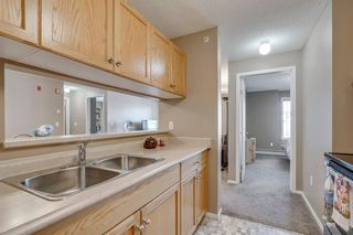 Photo 7: 3303 TUSCARORA Manor NW in Calgary: Tuscany Apartment for sale : MLS®# A1036572