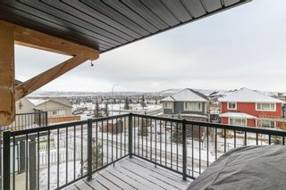 Photo 25: 703 Jumping Pound Common: Cochrane Row/Townhouse for sale : MLS®# A1064956