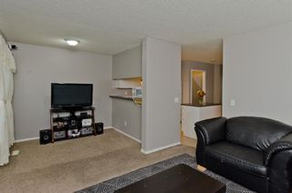 Photo 16: 163 Stonemere Place: Chestermere Row/Townhouse for sale : MLS®# A1040749