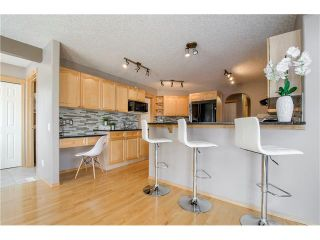 Photo 10: 69 STRATHLEA Place SW in Calgary: Strathcona Park House for sale : MLS®# C4101174