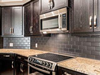 Photo 9: 205 33 6A Street NE in Calgary: Bridgeland/Riverside Apartment for sale : MLS®# A1127361