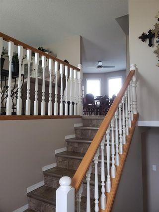 Photo 2: 105 Fairway View: High River Row/Townhouse for sale : MLS®# A1152855