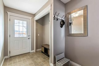 Photo 4: 6 Crystal Shores Cove: Okotoks Row/Townhouse for sale : MLS®# A1080376