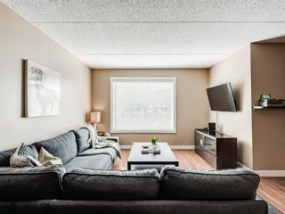 Photo 4: 408 2200 Woodview Drive SW in Calgary: Woodlands Row/Townhouse for sale : MLS®# A1087081