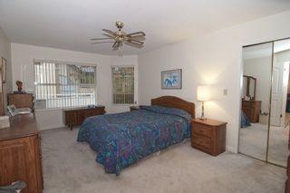 "Photo 7: 221 7156 121 Street in Surrey: West Newton Townhouse for sale in ""Glenwood Village"" : MLS®# R2215838"