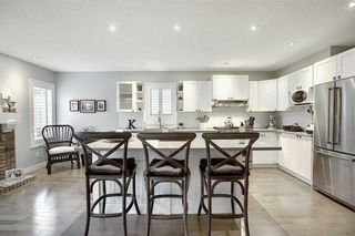 Photo 5: 231 COACHWAY Road SW in Calgary: Coach Hill Detached for sale : MLS®# C4305633