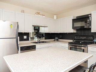 Photo 1: 208 1305 Glenmore Trail SW in Calgary: Kelvin Grove Row/Townhouse for sale : MLS®# A1082962