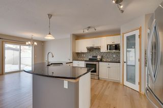 Photo 13: 106 Arbour Butte Road NW in Calgary: Arbour Lake Detached for sale : MLS®# A1075299
