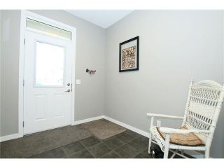 Photo 2: 510 RIVER HEIGHTS Crescent: Cochrane House for sale : MLS®# C4074491