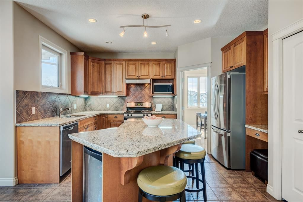 Main Photo: 604 Tuscany Springs Boulevard NW in Calgary: Tuscany Detached for sale : MLS®# A1085390