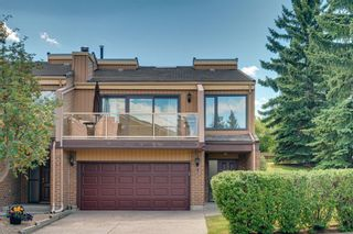 Photo 1: 1 1220 Prominence Way SW in Calgary: Patterson Row/Townhouse for sale : MLS®# A1144059