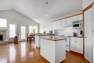 Photo 6: 26 HIDDEN RANCH Road NW in Calgary: Hidden Valley House for sale