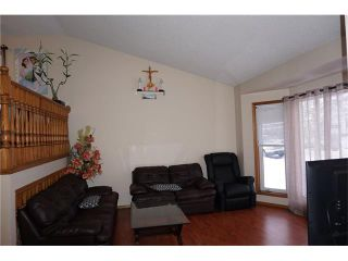 Photo 5: 260 ERIN MEADOW Close SE in Calgary: Erin Woods House for sale : MLS®# C4095343