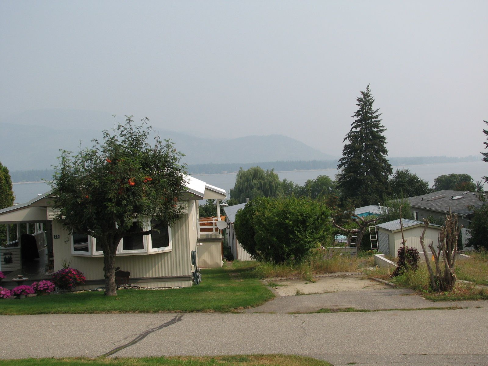 Smoke in the air is masking a beautiful lakeview