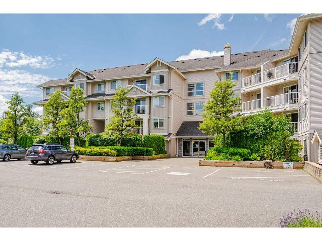 """Photo 1: Photos: 204 19366 65 Avenue in Surrey: Clayton Condo for sale in """"LIBERTY AT SOUTHLANDS"""" (Cloverdale)  : MLS®# R2591315"""