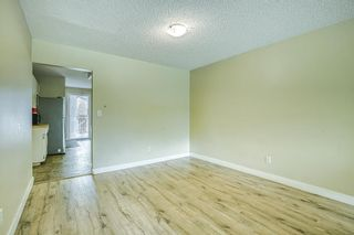 """Photo 11: 8676 E TULSY Crescent in Surrey: Queen Mary Park Surrey Townhouse for sale in """"Bear Creek Estates"""" : MLS®# R2463372"""