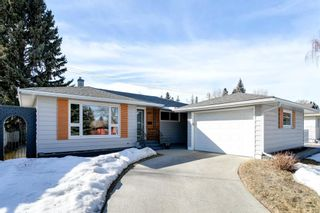 Photo 1: 8207 7 Street SW in Calgary: Kingsland Detached for sale : MLS®# A1080645