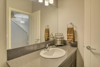 Photo 26: 643 101 Sunset Drive N: Cochrane Row/Townhouse for sale : MLS®# A1117436