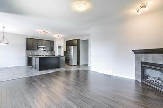 Photo 7: 61 Everhollow Green SW in Calgary: Evergreen Detached for sale : MLS®# A1115077